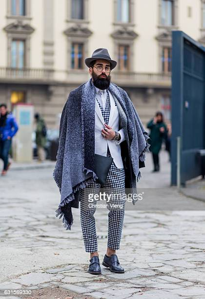 Emanuele Bonomini is wearing a grey scarf, grey hat, checed suit, leather shoes on January 12, 2017 in Florence, Italy.