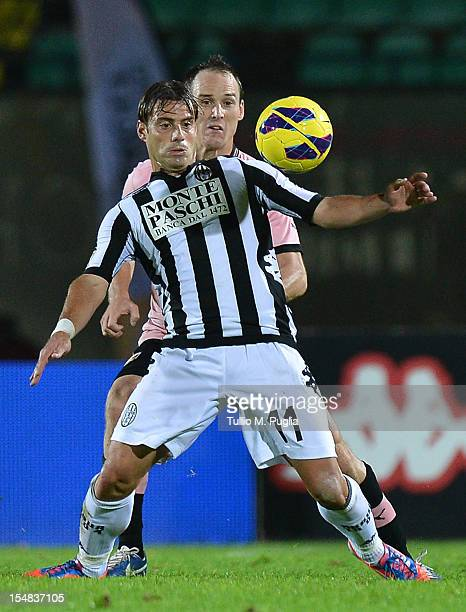 Emanuele Calaio of Siena controls the ball as Steve Von Bergen of Palermo tackles during the Serie A match between AC Siena and US Citta di Palermo...