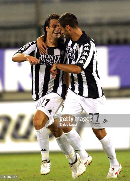 Emanuele Calaio of Siena is congratulated by Daniele Ficagna after scoring the during the Serie A match between Cagliari Calcio and AC Siena at...