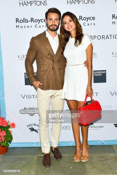 Emanuele Fiore and Karla Acevedo attend Peebles Corporation And RollsRoyce Saddle Up With Georgina Bloomberg Give Back For Special Equestrians For...