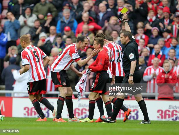 Emanuele Giaccherini celebrates scoring the third Sunderland goal with John O'Shea and gets a yellow card for his celebration during the Barclays...
