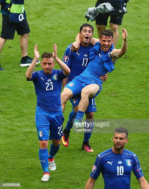 Emanuele Giaccherini Eder and Alessandro Florenzi of Italy celebrate their team's 20 win in the UEFA EURO 2016 round of 16 match between Italy and...
