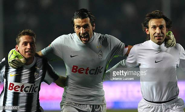 Emanuele Giaccherini Gianluigi Buffon and Andrea Pirlo of Juventus FC celebrate a victory at the end of the Serie A match between Atalanta BC and...