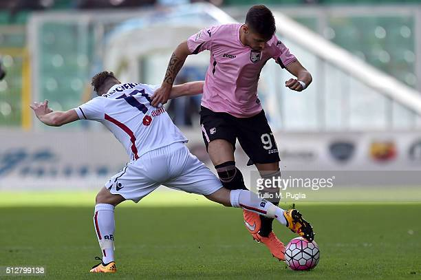 Emanuele Giaccherini of Bologna and Gisuseppe Pezzella of Palermo compete for the ball during the Serie A match between US Citta di Palermo and...