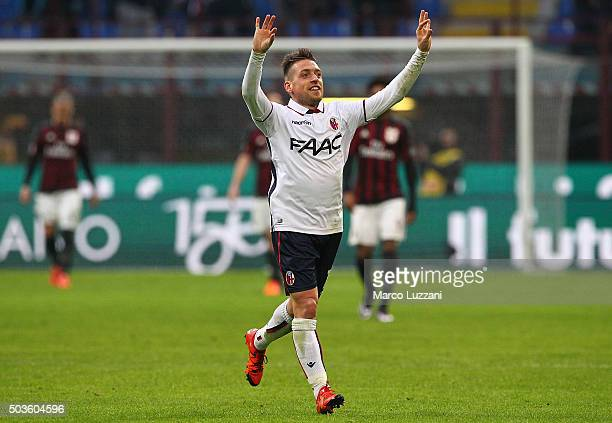 Emanuele Giaccherini of Bologna FC celebrates after scoring the opening goal during the Serie A match between AC Milan and Bologna FC at Stadio...