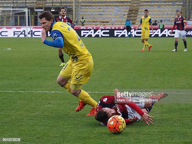 Emanuele Giaccherini of Bologna FC is fouled by Nicolas Frey of Chievo Verona in the penalty area during the Serie A match between Bologna FC and AC...
