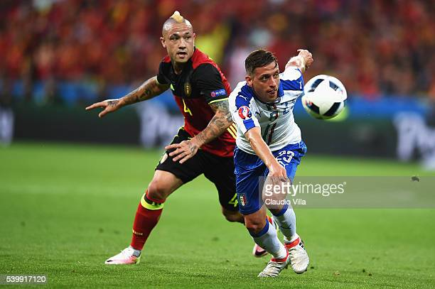 Emanuele Giaccherini of Italy and Radja Nainggolan of Belgium compete for the ball during the UEFA EURO 2016 Group E match between Belgium and Italy...