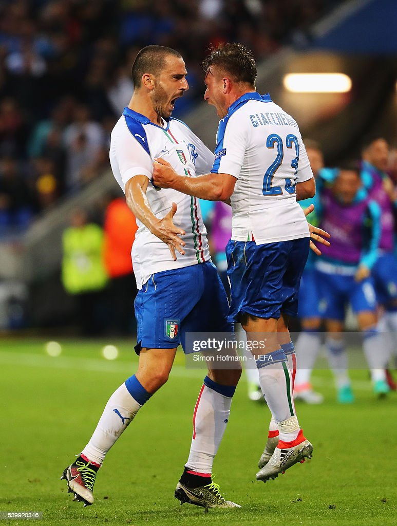 Emanuele Giaccherini (R) of Italy celebrates scoring his team's first goal with his team mate Leonardo Bonucci (L) during the UEFA EURO 2016 Group E match between Belgium and Italy at Stade des Lumieres on June 13, 2016 in Lyon, France.