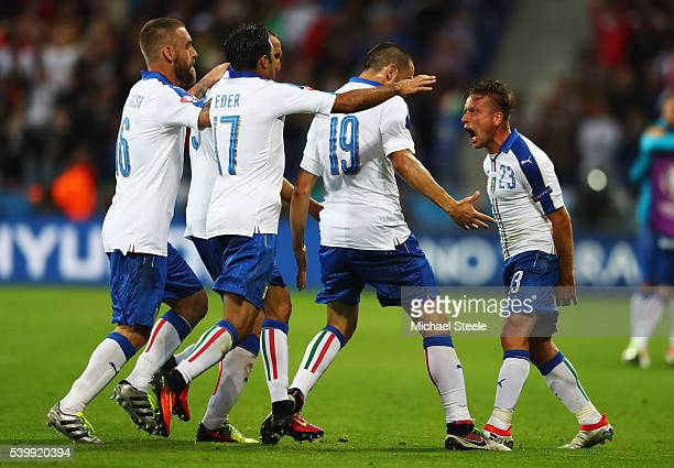 Emanuele Giaccherini of Italy celebrates scoring his team's first goal with his team matesduring the UEFA EURO 2016 Group E match between Belgium and...