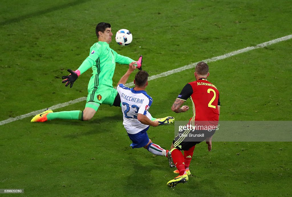 Emanuele Giaccherini (C) of Italy scores his team's first goal past Thibaut Courtois of Belgium during the UEFA EURO 2016 Group E match between Belgium and Italy at Stade des Lumieres on June 13, 2016 in Lyon, France.