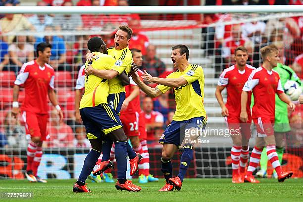 Emanuele Giaccherini of Sunderland celebrates with teammates after scoring the opening goal during the Barclays Premier League match between...