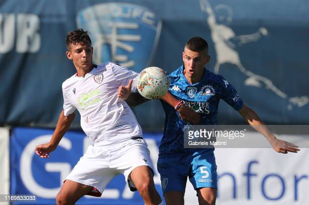 Emanuele Matteucci of Empoli FC U19 battles for the ball with Luca Gagliano of Cagliari U19 during the Serie A Primavera match between Empoli U19 and...