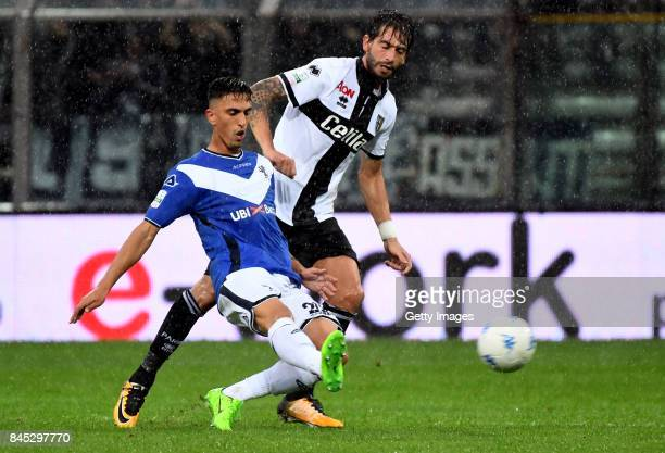 Emanuele Ndoj of Brescia Calcio competes for the ball whit Gianni Munari of Parma Calcio during the Serie B match between Parma Calcio and Brescia...