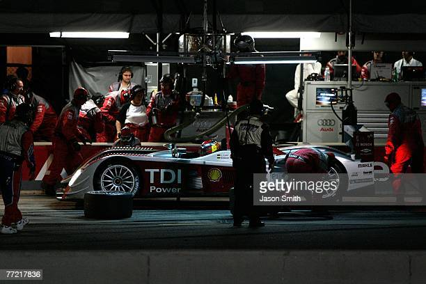 Emanuele Pirro and Marco Werner drivers of the Audi Sport North America Audi AG R10/TDI makes a pit stop during the 10th Anniversary Petit Le Mans at...