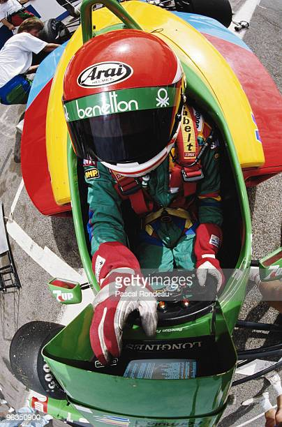 Emanuele Pirro checks the lap times as he replaces Johnny Herbert in the BenettonFord B188 during practice for the French Grand Prix on 8th July 1989...