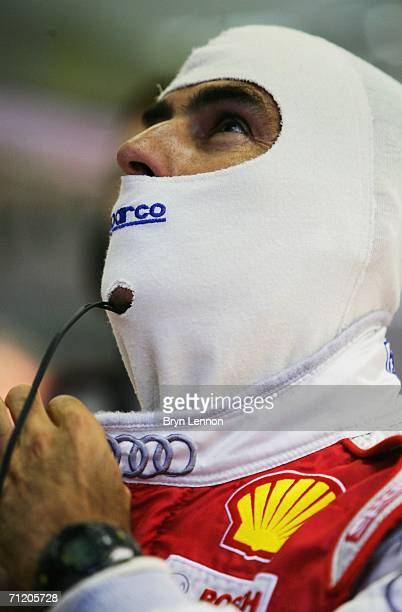 Emanuele Pirro of Italy and Audi checks his lap times during 1st qualifying for the Le Mans 24h race at the Circuit des '24 Heures du Mans' on June...