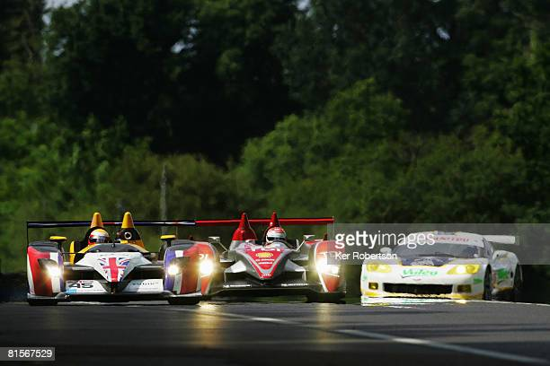 Emanuele Pirro of Italy and Audi Sport North America makes his way through slower traffic during the 76th running of the Le Mans 24 Hour race at the...