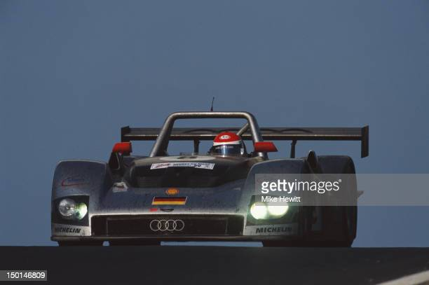 Emanuele Pirro of Italy drives the Audi Sport Team Joest Audi R8R during the 24 Hours of Le Mans race on 13th June 1999 at the Circuit de la Sarthe...
