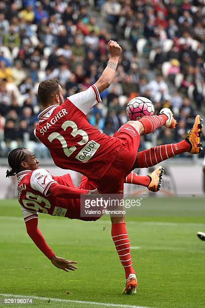 Emanuele Suagher of Carpi FC clashes with his team mate Jerry Uche Mbakogu during the Serie A match between Juventus FC and Carpi FC at Juventus...