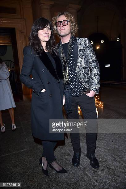 Emanuelle Alt and Peter Dundas attend Vogue Cocktail Party honoring photographer Mario Testino on February 27 2016 in Milan Italy