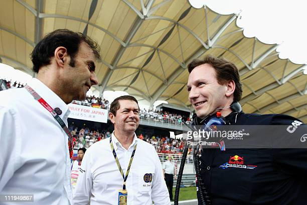 Emanuelle Pirro talks with Red Bull Racing Team Principal Christian Horner on the grid before the Malaysian Formula One Grand Prix at the Sepang...