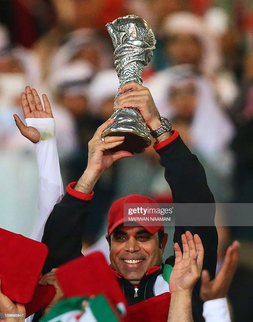Emarati coach Mahdi Ali raises the trophy after his team won the final of the 21st Gulf Cup on January 18, 2013 in Manama. United Arab Emirates won 2-1 against Iraq.