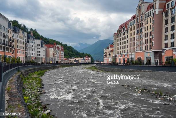 embankment in the mountain village of krasnaya polyana - summits russia 2015 stock pictures, royalty-free photos & images