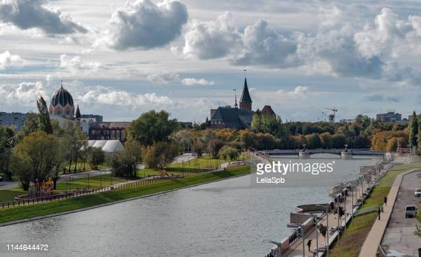 embankment of the river pregolya in autumn with a great sky - kaliningrad stock pictures, royalty-free photos & images