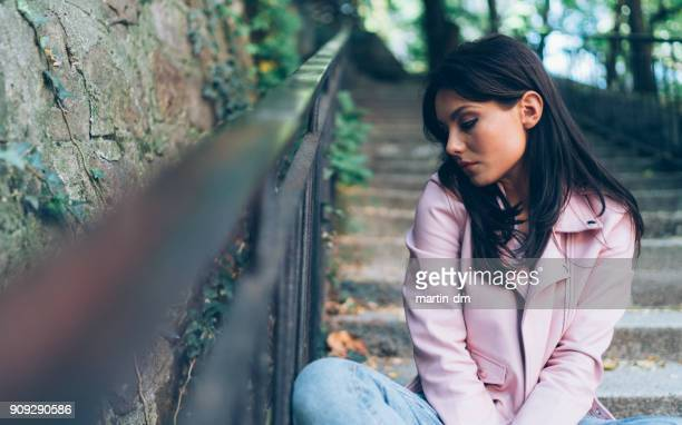 embarrassed teenage girl - victim stock pictures, royalty-free photos & images