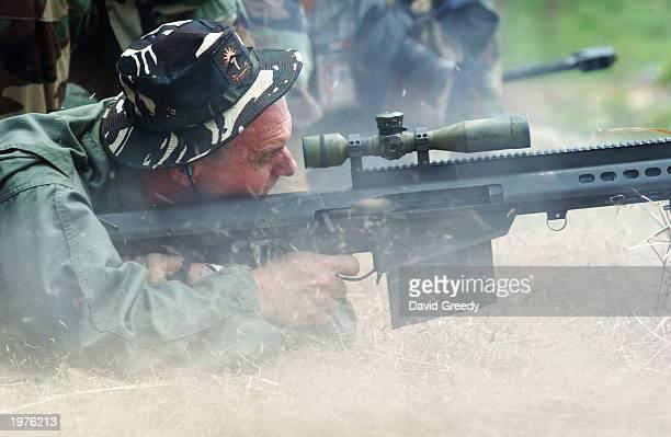 S Embassador to the Philippines Francis Ricciardone Jr fires a 50 caliber sniper rifle on May 6 during 'Balikatan 03' exercises at Ft Magsaysay in...