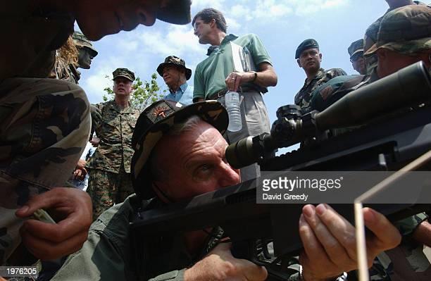 S Embassador to the Philippines Francis Ricciardone Jr prepares to fire a 50 caliber sniper rifle on May 6 during 'Balikatan 03' exercises at Ft...