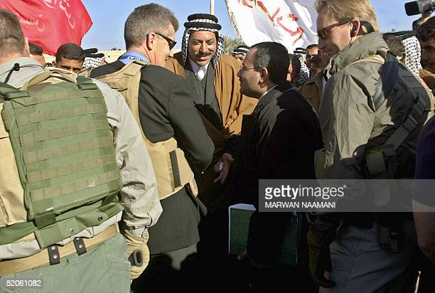 US embassy official greets Sheikh Muthana Hatem chief of Bani Hassan Tribe an independent election candidate in the town of As Sulayiyah near the...