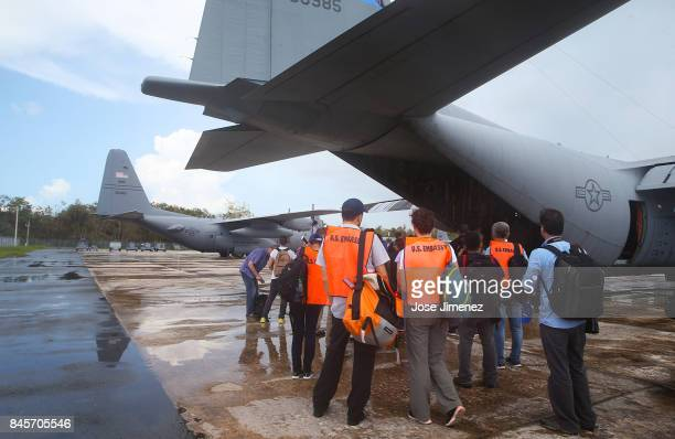 S Embassy personel and media prepare to board a National Guard C130 plane enroute to Saint Martin September 11 2017 in San Juan Puerto Rico US...