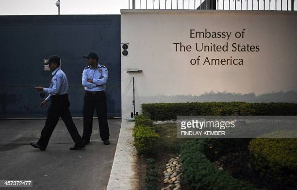 Embassy security personnel watch after barricades were removed in front of the US Embassy in New Delhi on December 17, 2013. India launched a series...