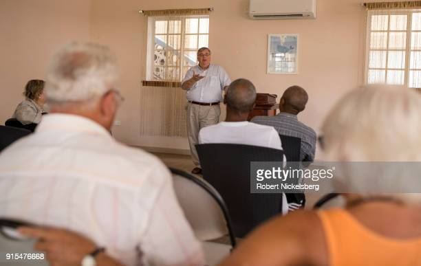 Embassy to Grenada Principal Officer Stephen Frahm center right speaks with citizens of the United States of America left about what the US...