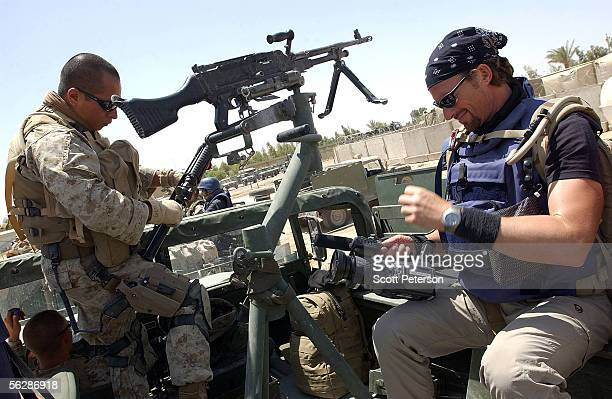 Embedded reporter Kevin Sites of NBC rides in the back of a US Marines vehicle to a checkpoint May 1 2004 at the edge of Fallujah Iraq Marines...