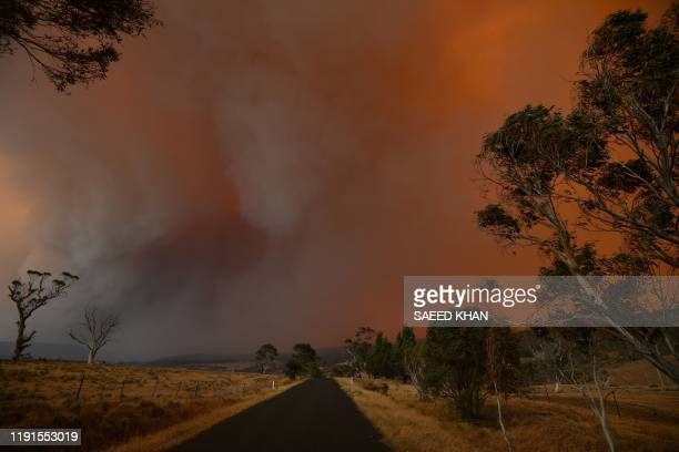 Ember and thick smoke from bushfires reach Braemar Bay in New South Wales on January 4 2020 Up to 3000 military reservists were called up to tackle...