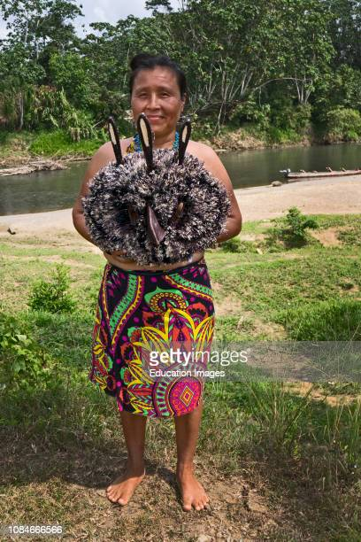 Embera Indian woman from Nuevo Vigia on the Rio Tuquesa with a handmade mask of the Harpy Eagle in the Darien, Panama.