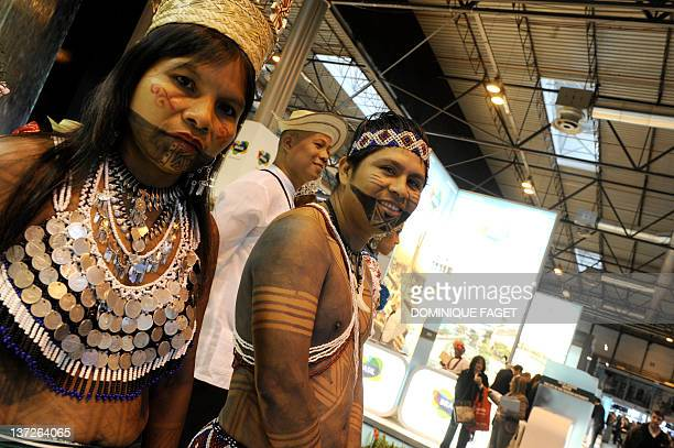 Embera Indians are pictured at the Panama stand during the inauguration of the International Tourism Trade Fair in Madrid on January 18 2012...