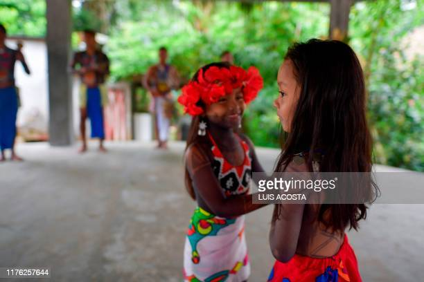 Embera indigenous child dance during the preparation of a giant patacon fried flattened pieces of green plantains in Ipeti Embera Chepo Distric...