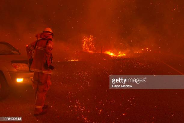 Embers fall around a photographer as the Creek Fire rapidly expands on September 8, 2020 near Shaver Lake, California. California Gov. Gavin Newsom...