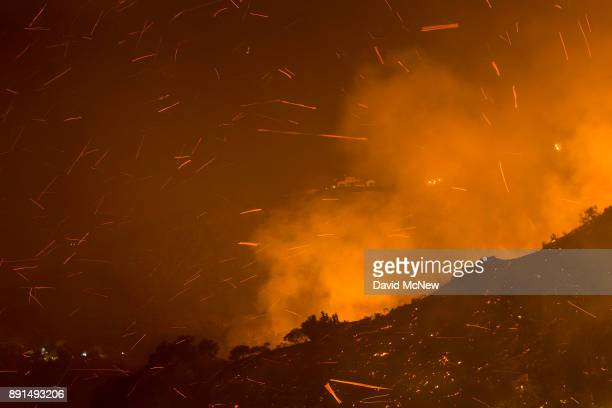 Embers fly as the Thomas Fire moves close to expensive homes on December 12 2017 in Montecito California The Thomas Fire has spread across 365 miles...