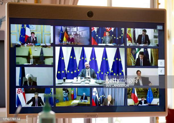 embers of the European Council are seen on the screen of a video conference call with French President at the Elysee Palace in Paris on April 23 as...