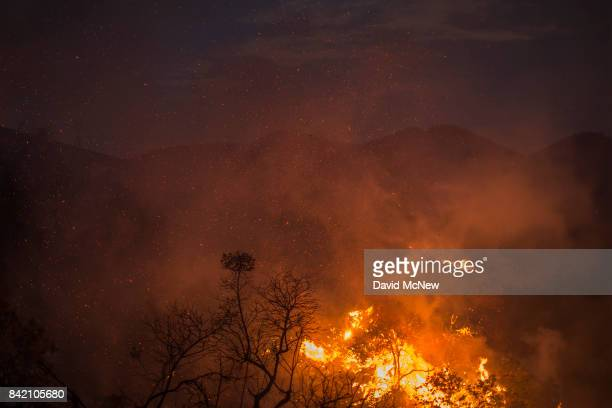 Embers rise as flames spread in the night at the La Tuna Fire on September 2 2017 near Burbank California Los Angeles Mayor Eric Garcetti said at a...