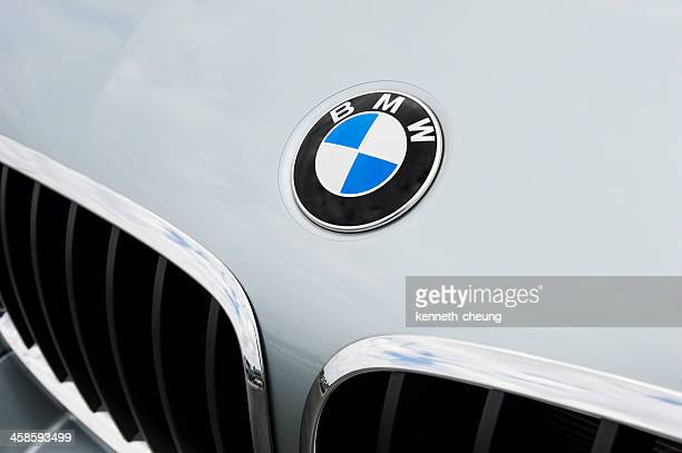 bmw emblem and kidney grille - bmw stock pictures, royalty-free photos & images
