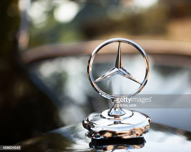 emblem logo on a mercedes - benz - mercedes stock photos and pictures