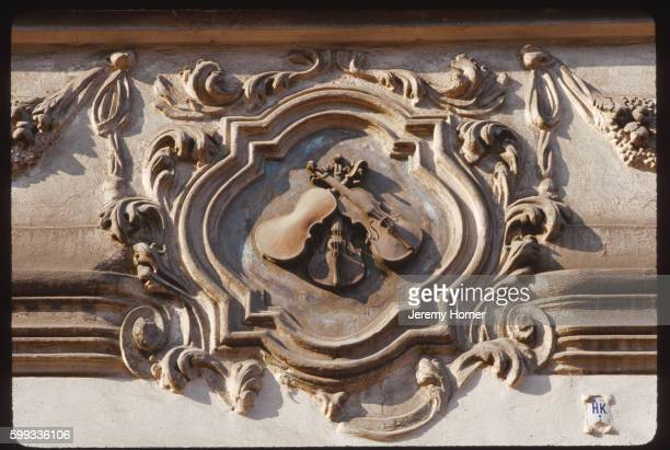 emblem on three little fiddles restaurant - insignia stock pictures, royalty-free photos & images