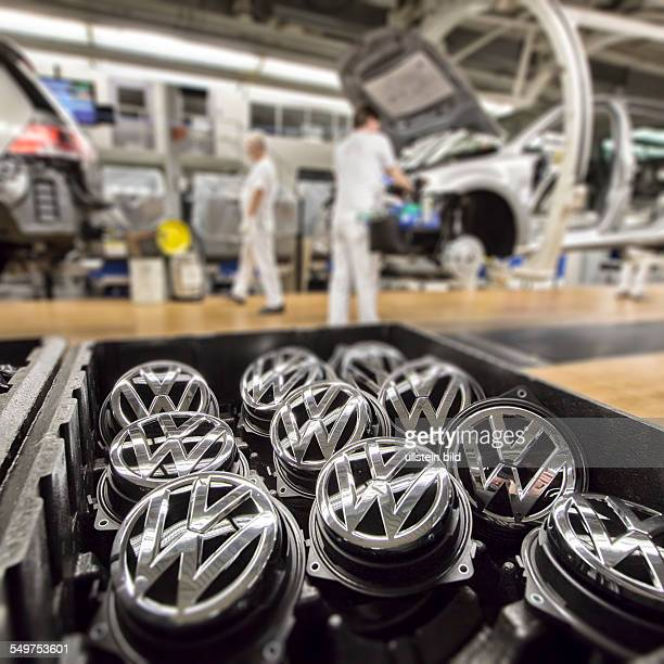 VW emblems in the production of the Golf 7 by Volkswagen in Wolfsburg Germany Europe