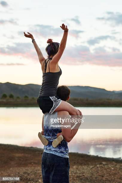 embrace the beauty of love and nature - carrying a person on shoulders stock photos and pictures