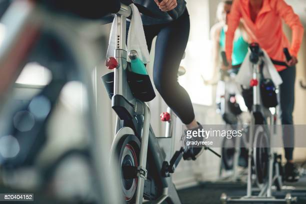 embrace the power of a bike - gym stock pictures, royalty-free photos & images